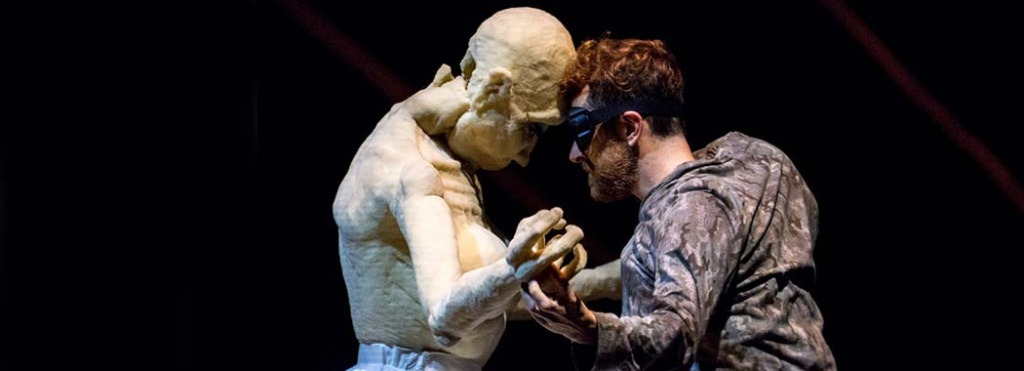performer with a large humanoid puppet