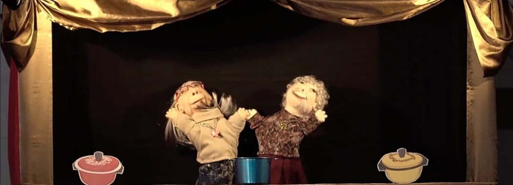 two hand puppets with paper pots