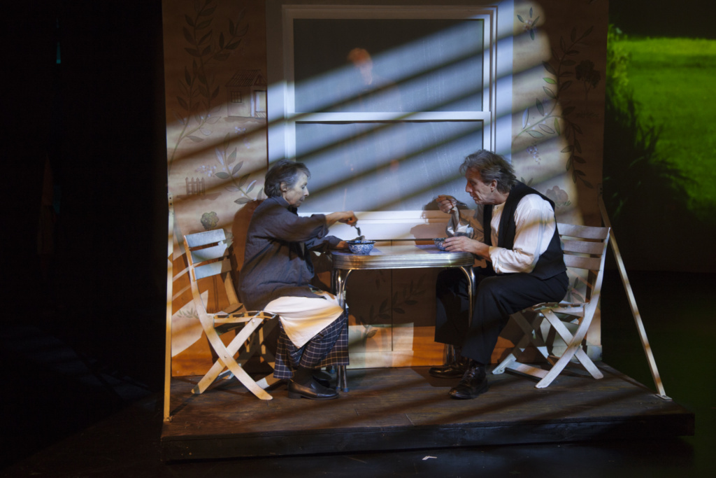 two performers sitting at a table as part of La MaMa Umbria