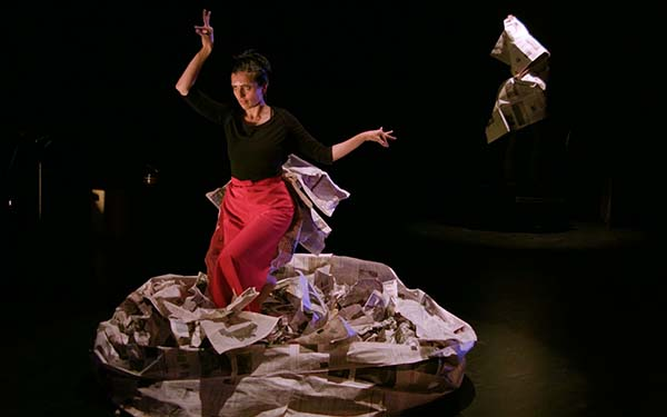 woman standing in the middle of a pile of paper