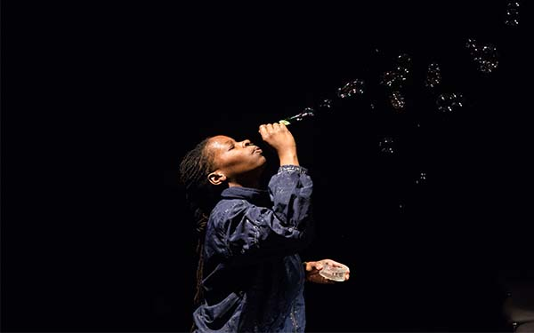 performer blowing bubbles