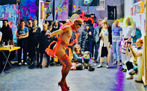 performer dancing in front of a group of people