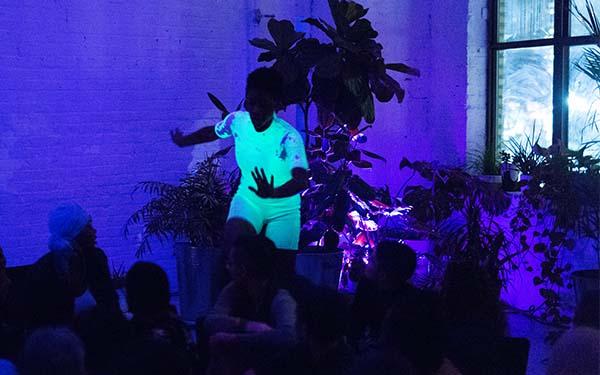 performer wearing a glowing green shirt
