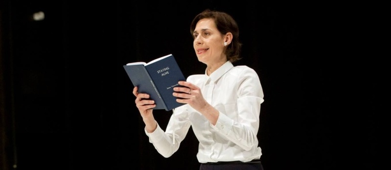 performer holding a book