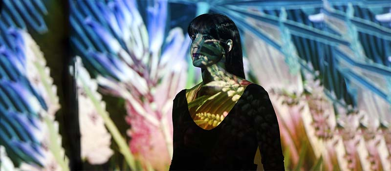 performer with projections on her body
