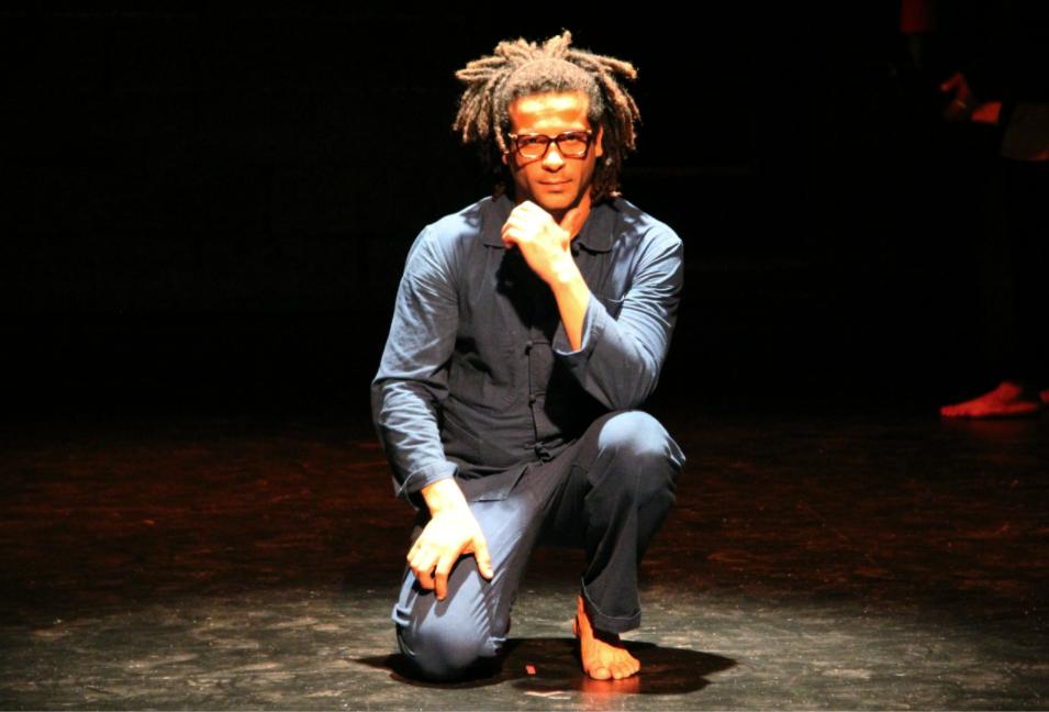 man crouching in a spotlight