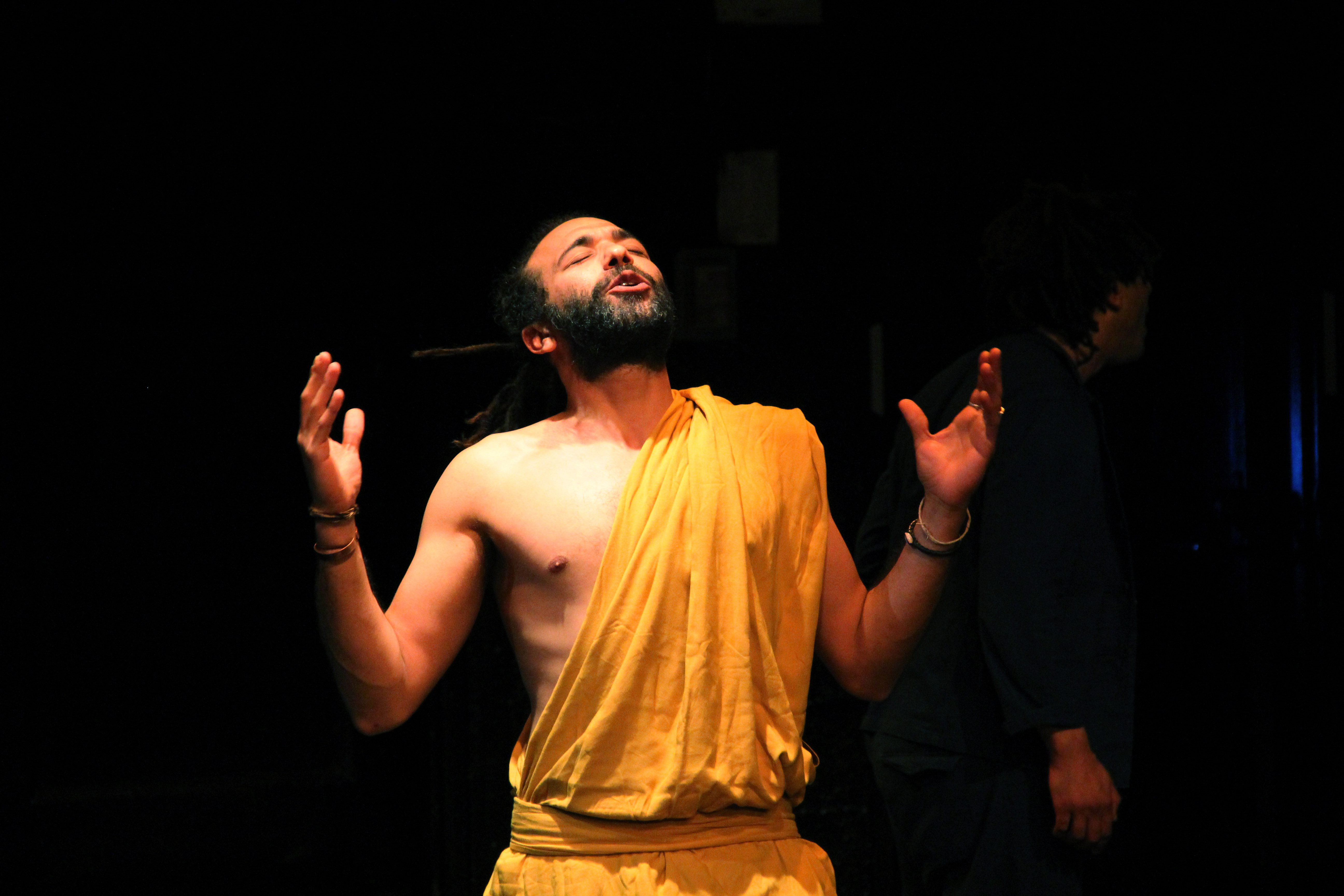 performer wearing yellow looking up