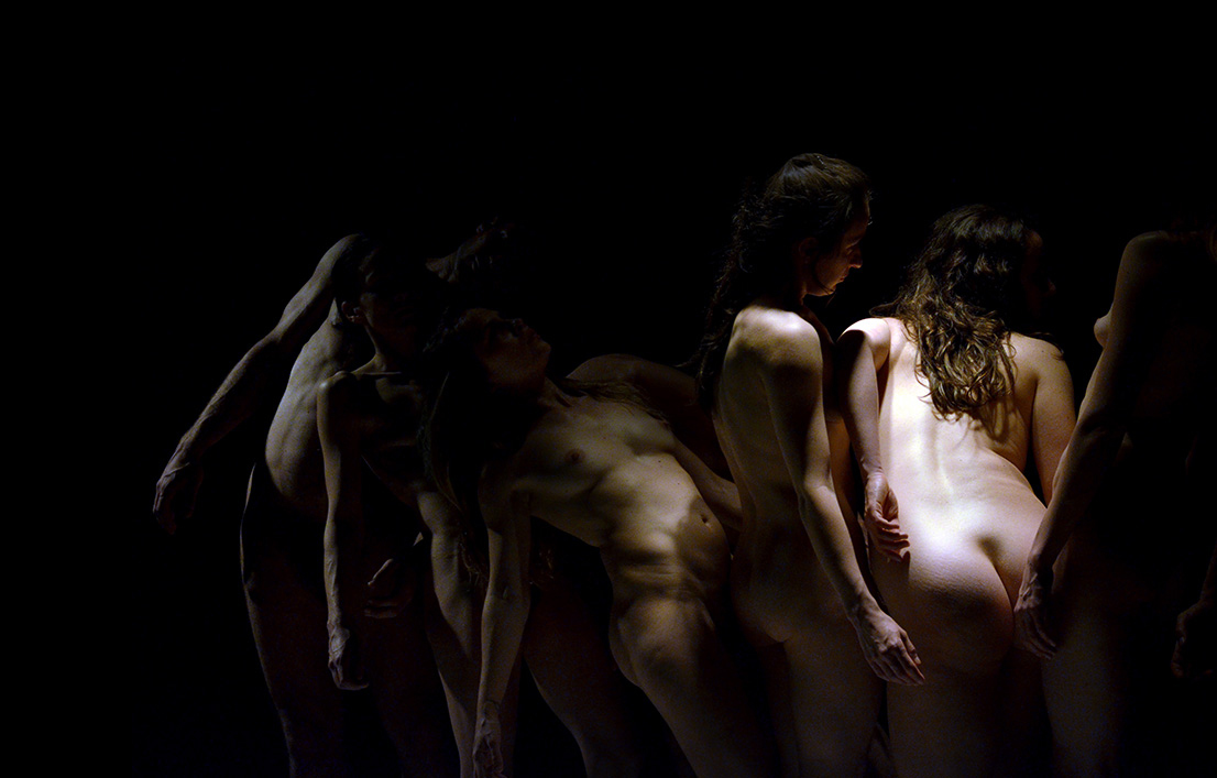 group of dancers in shadow
