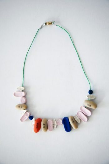 A necklace made of fake pills