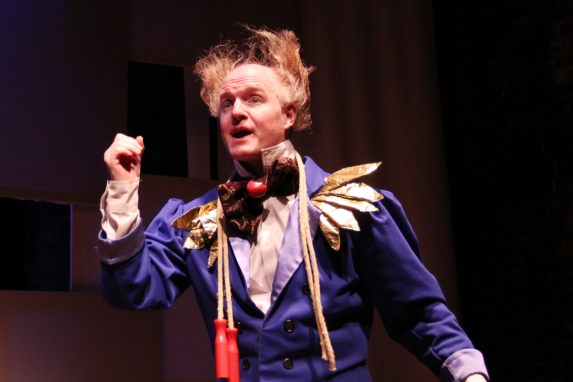 a performer wearing a blue jacket