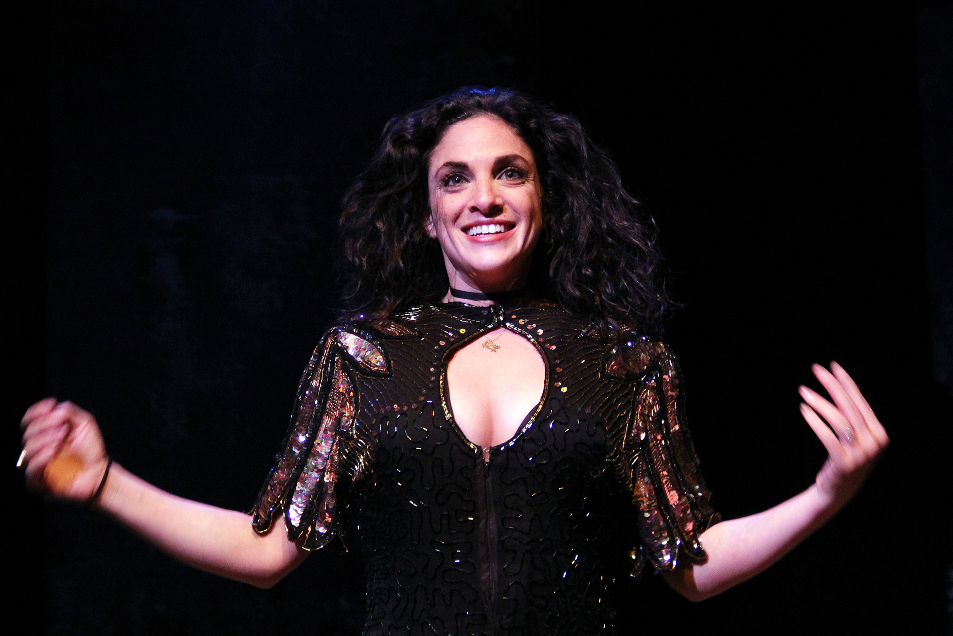 a performer wearing all black