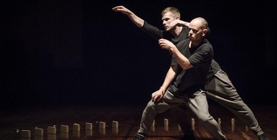 two performers wearing black dancing