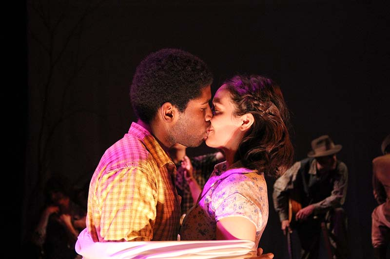 two performers kissing