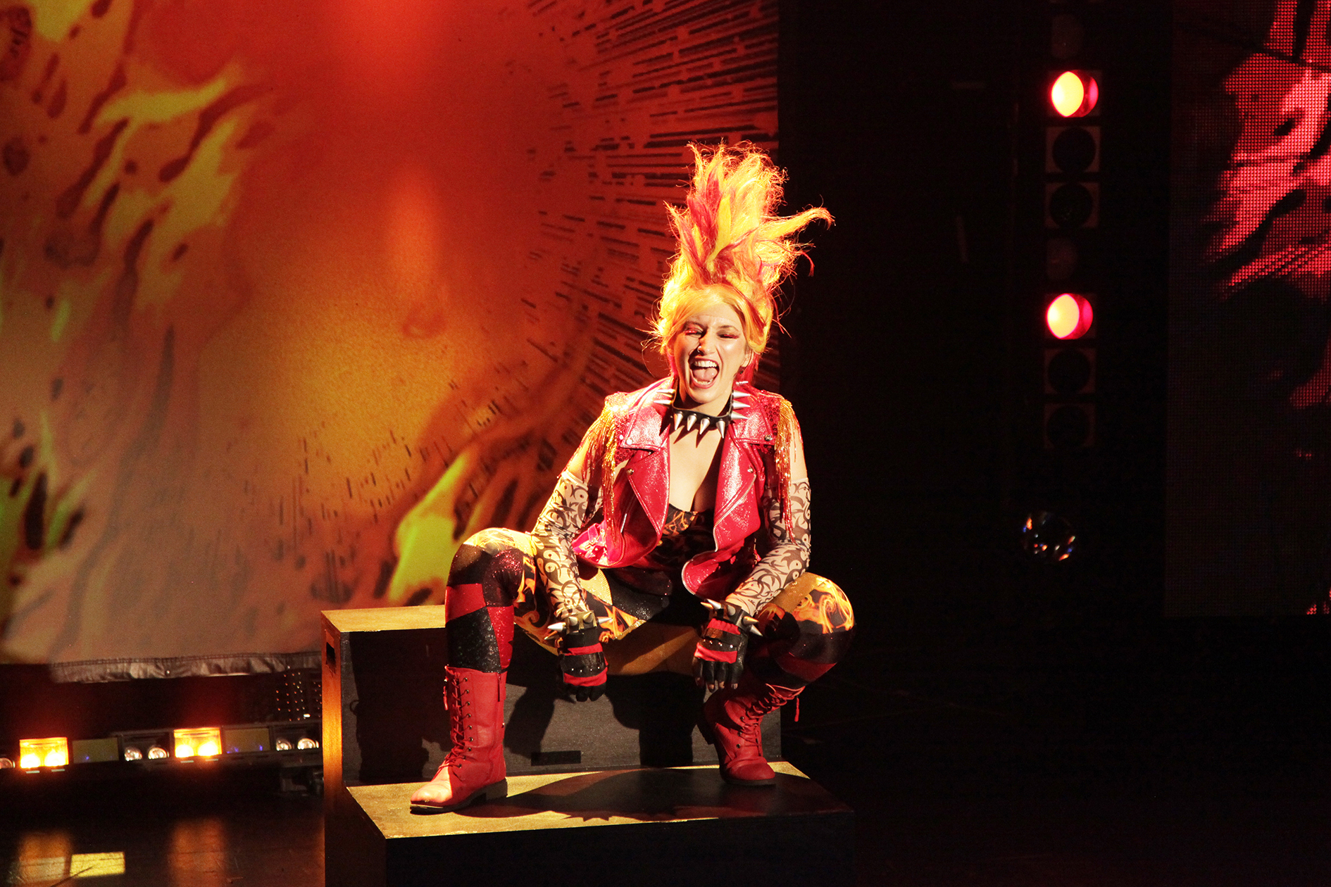 performer in a bright wig and boots
