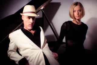 headshot of John Sully and Anastasia Krechet