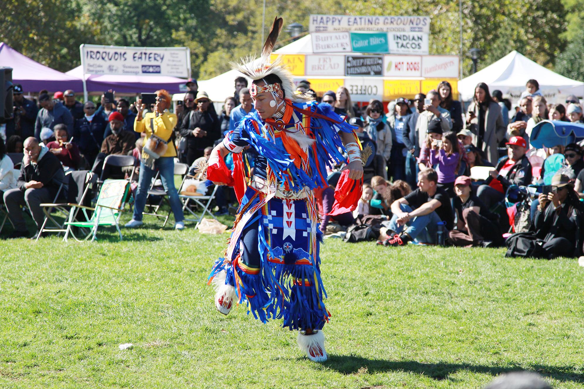 performer dancing in ceremonial dress