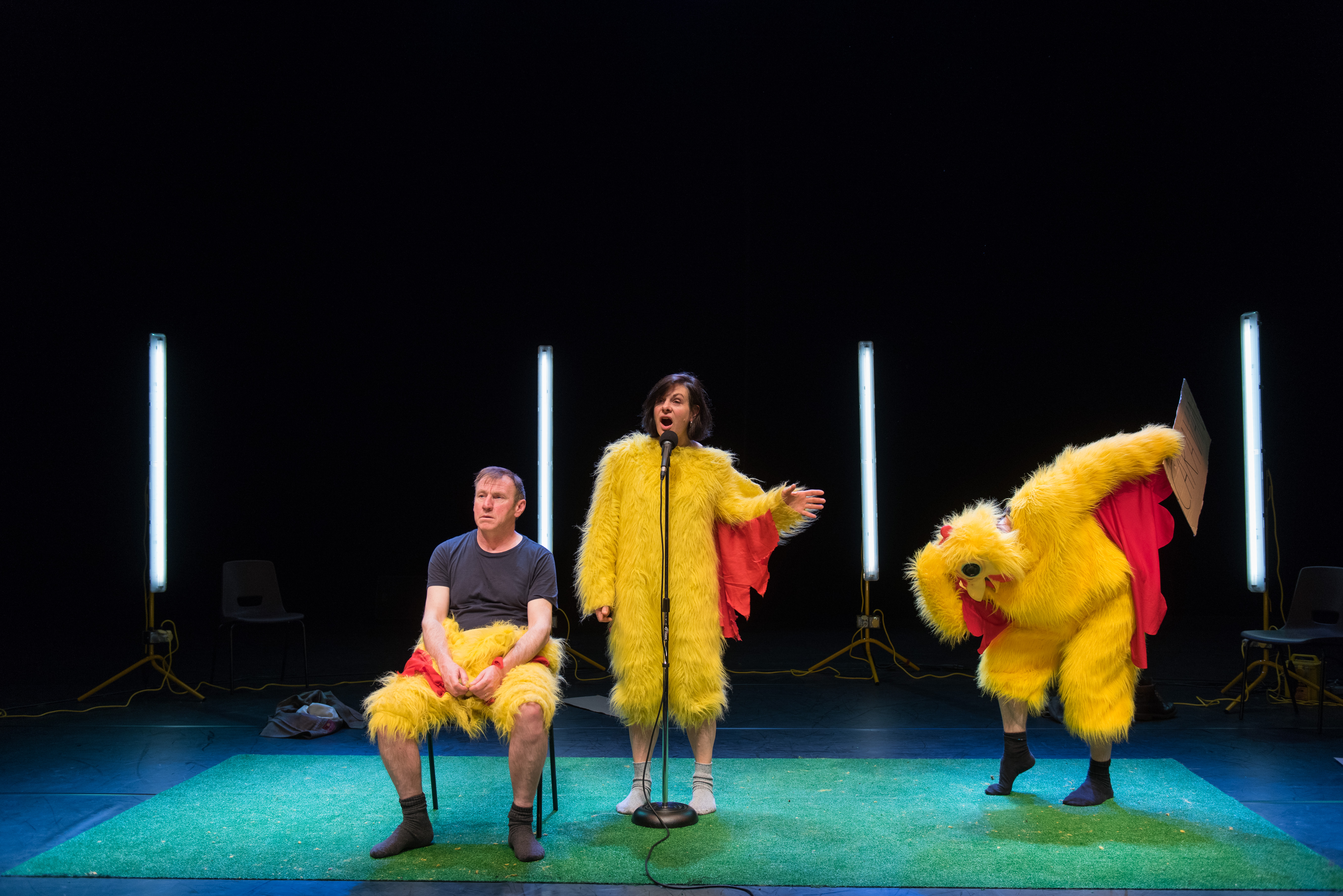 three performers in chicken costumes