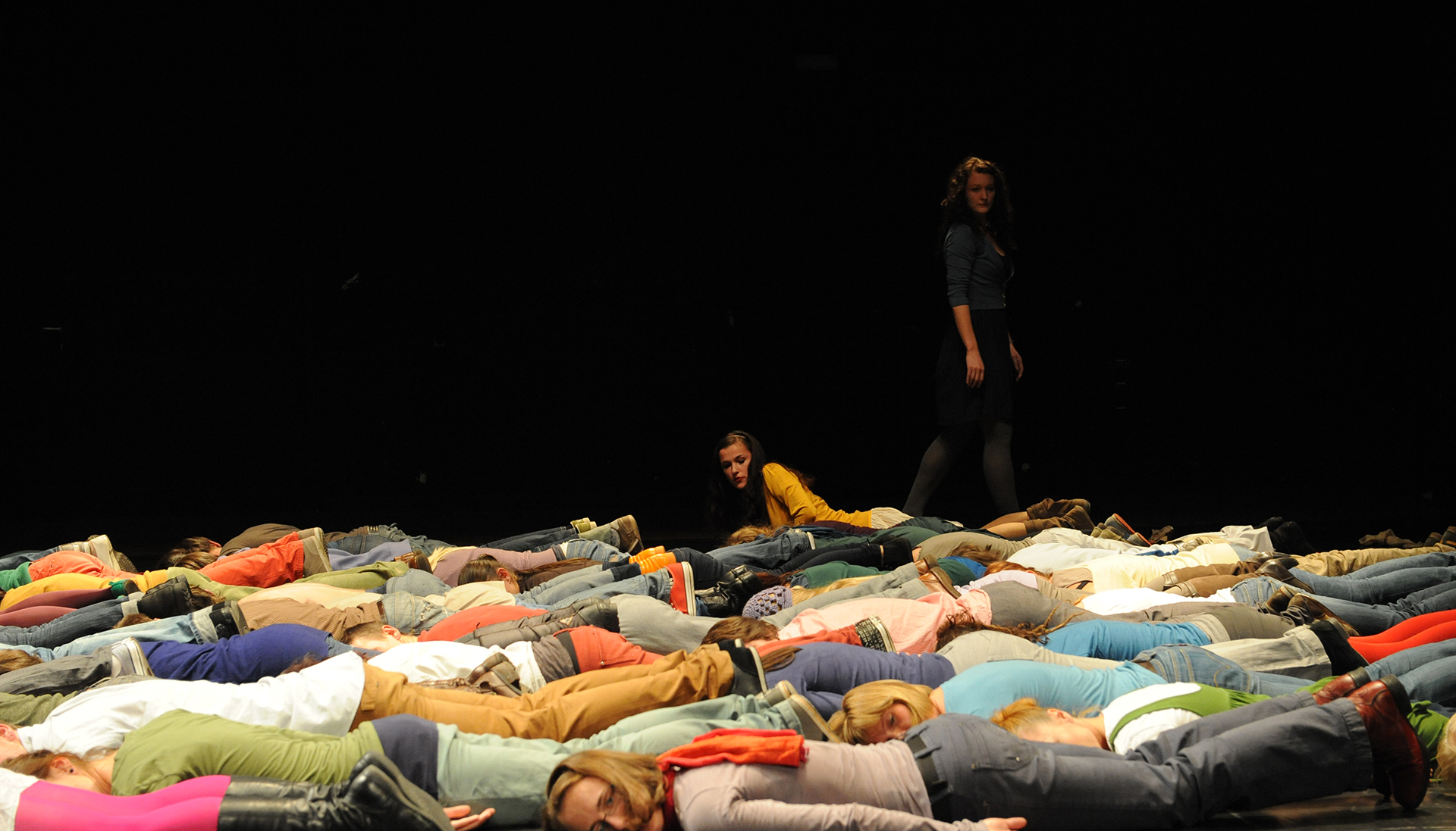 group of people laying on the ground
