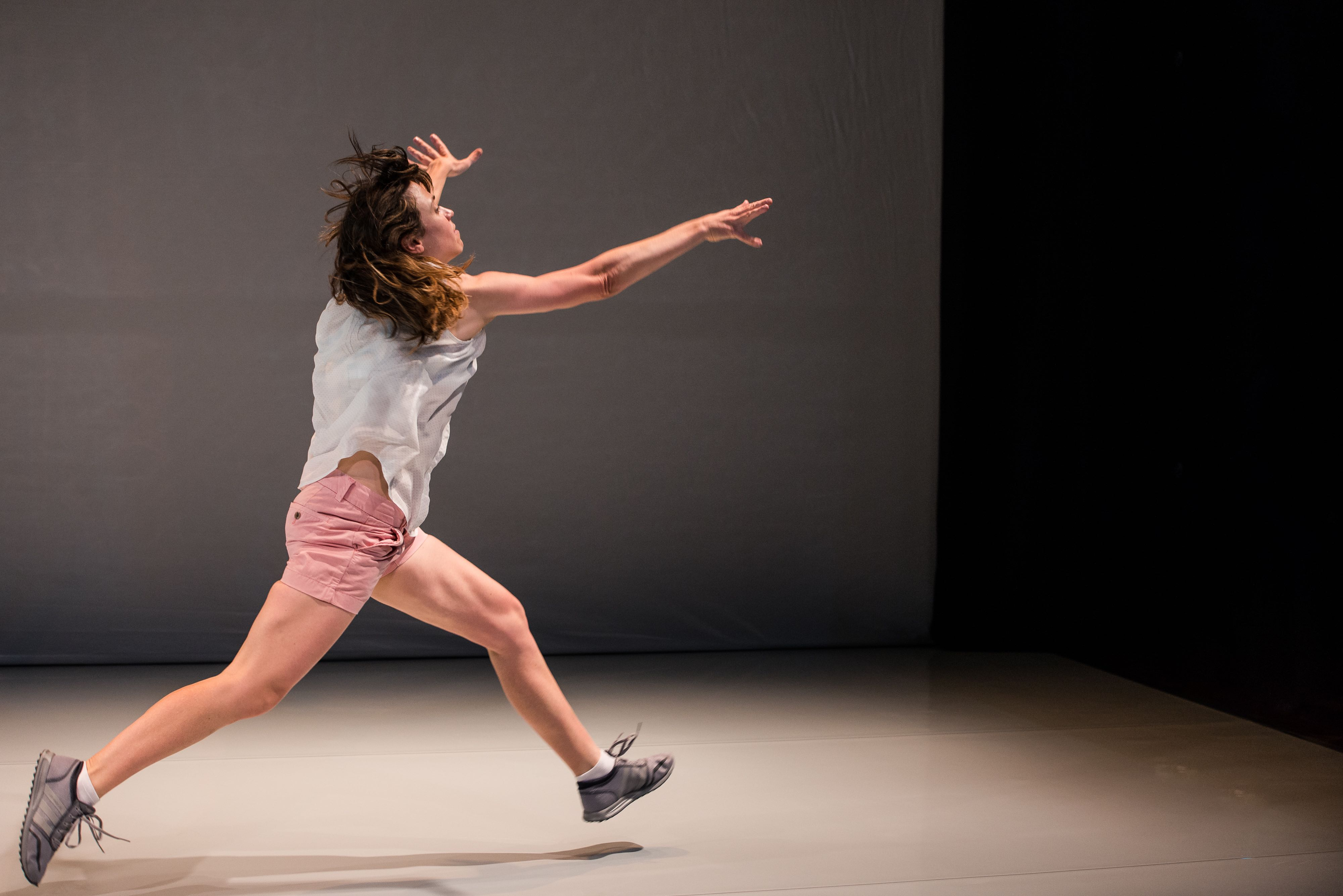 performer in white and pink dancing alone