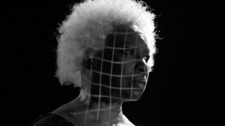 performer with a grid projected on their face