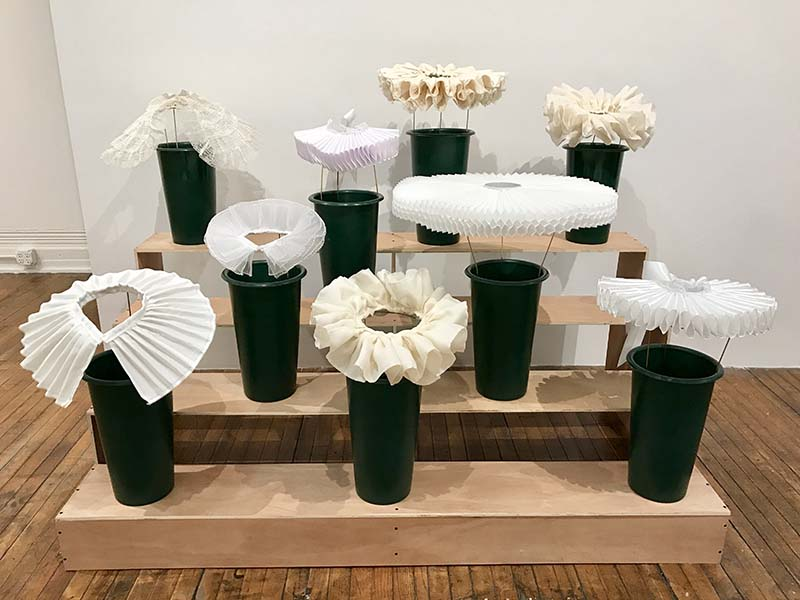 art exhibit of sculpture with white ruffles