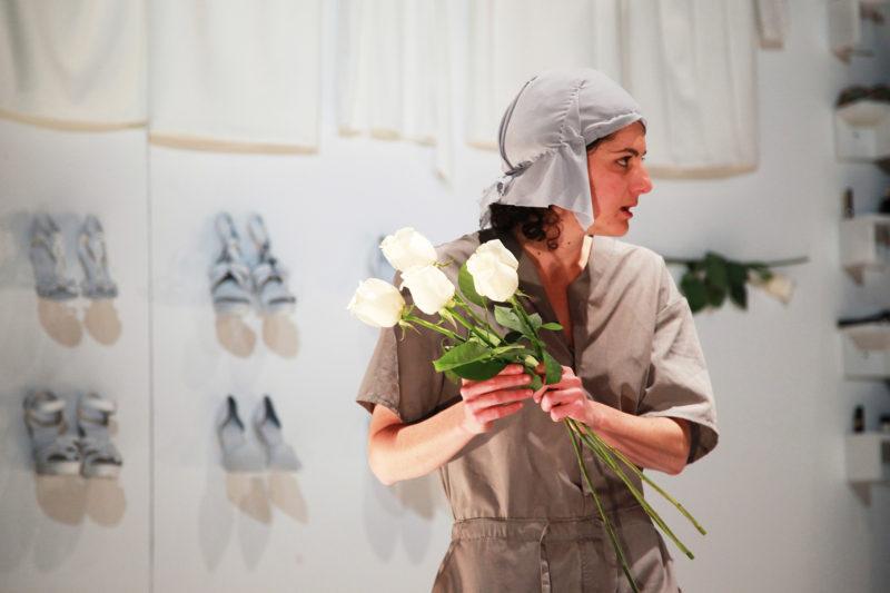 performer holding flowers