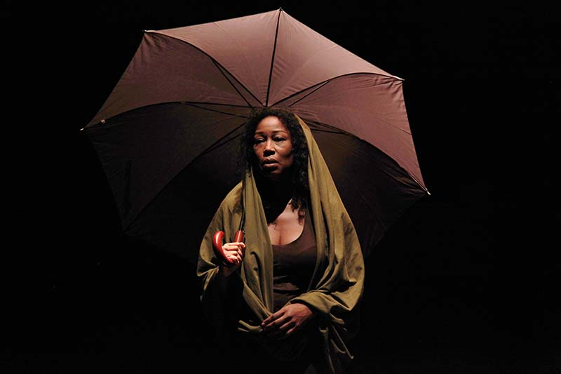 performer holding an umbrella