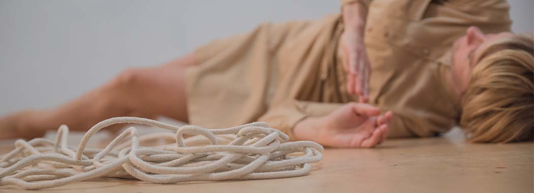 person laying next to rope