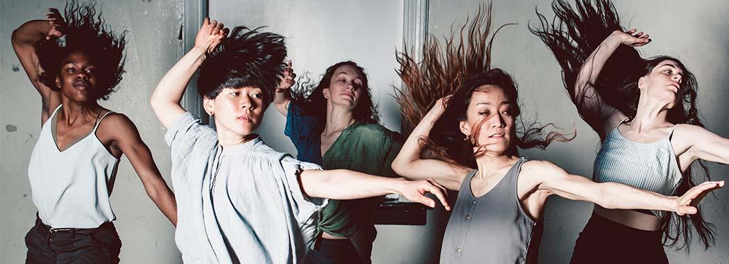 five performers dancing
