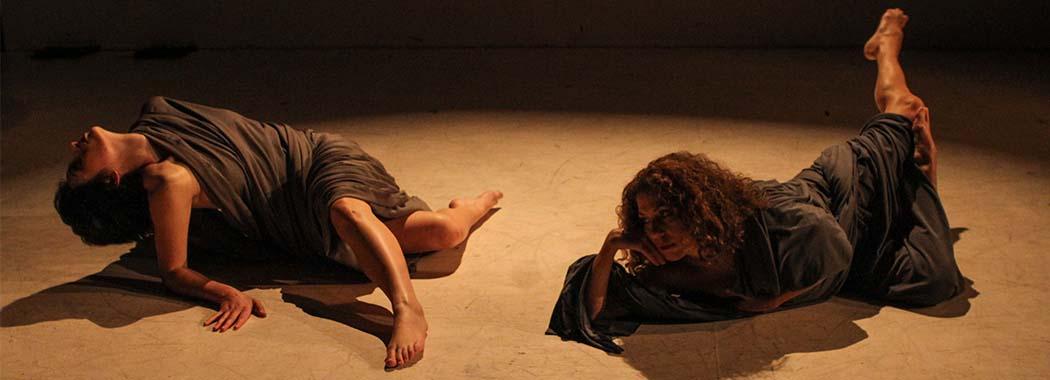 two people dancing in a spotlight