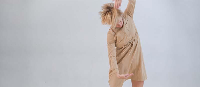 performer in a tan dress