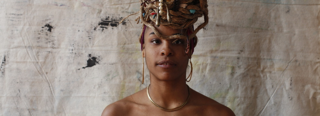 person with a gold headpiece