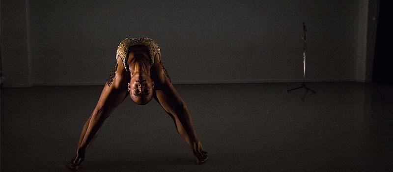 performer bending over backward