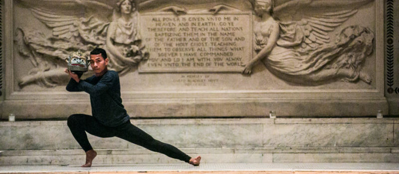 person dancing in front of a statue