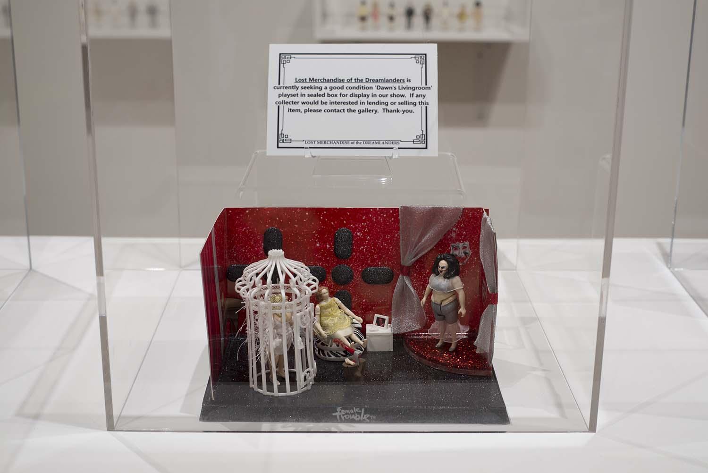 little doll set in a glass case