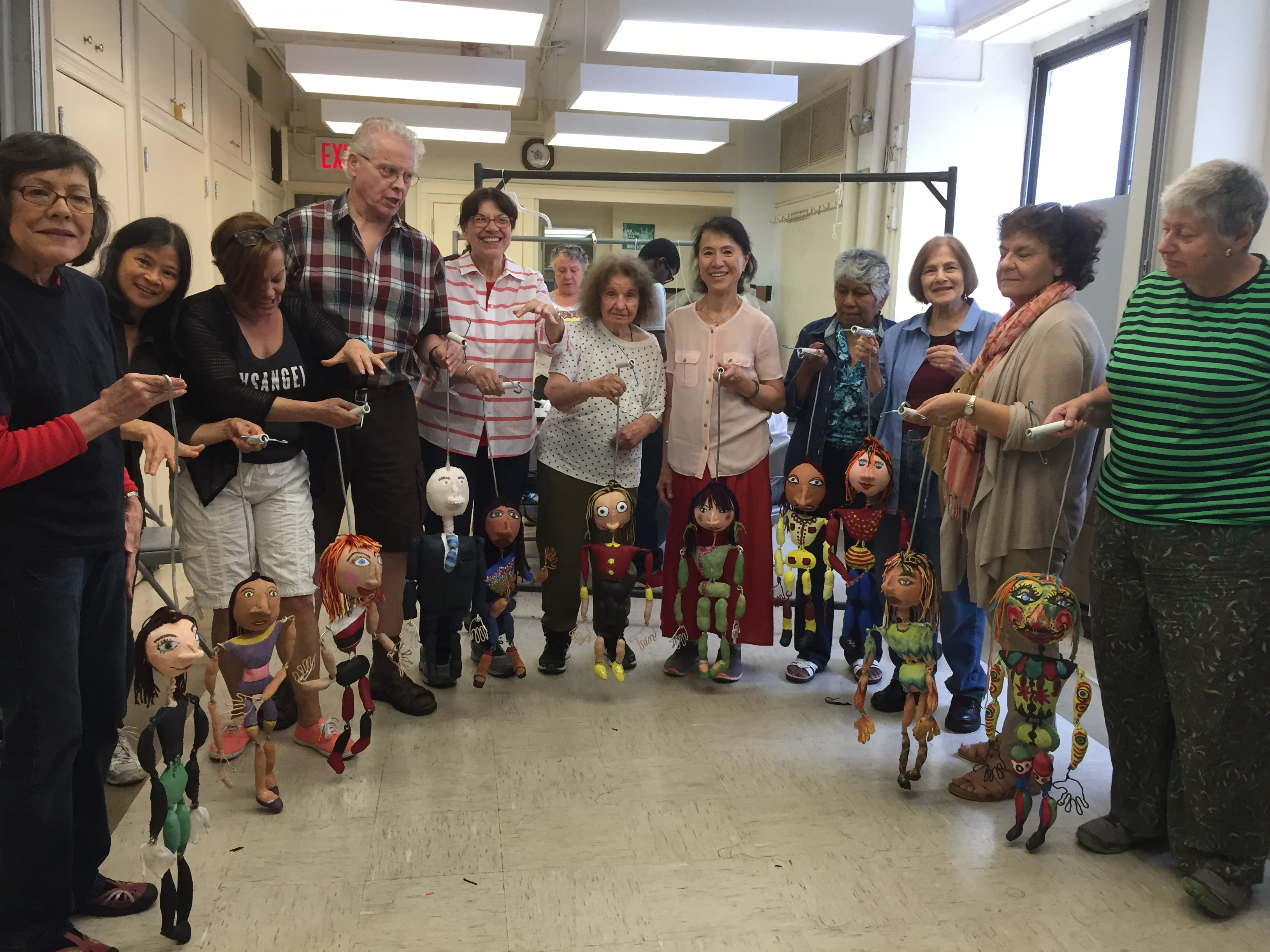 group of people with puppets