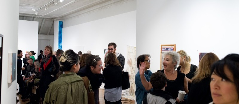 crowd of people in a gallery