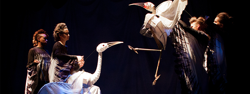 performers with crane puppets