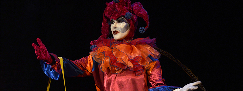 performer in a red costume