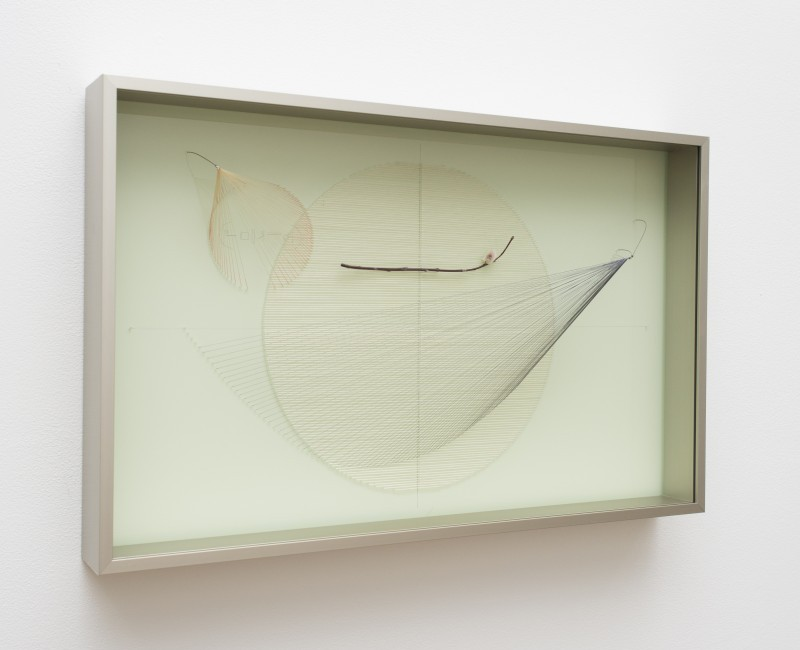 white art piece with string