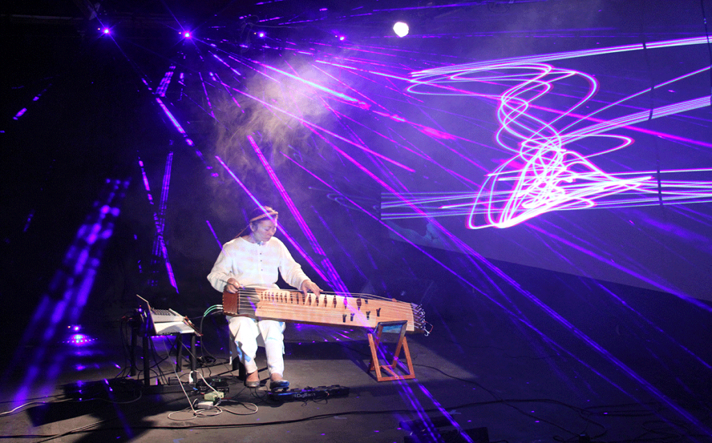 a person playing a string instrument with purple lights overhead
