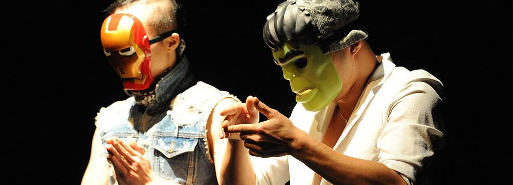 performer wearing an iron man and hulk mask