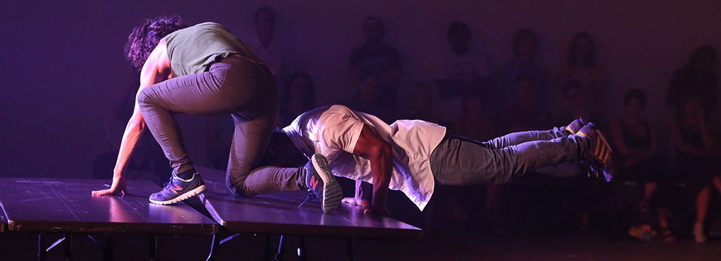 two performers moving on the ground