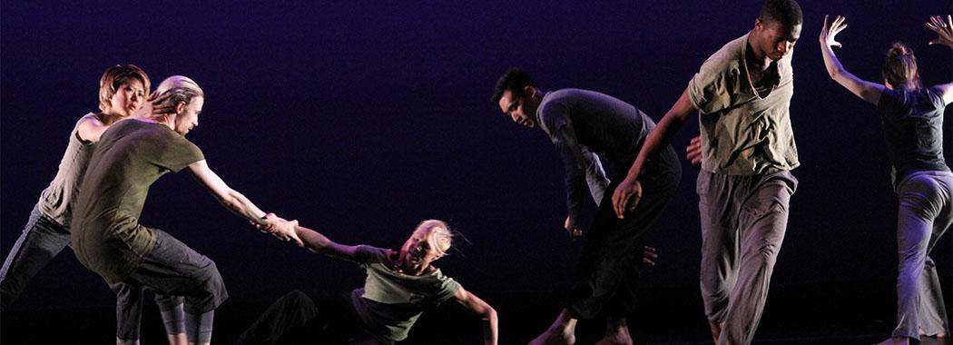 group of dancers onstage