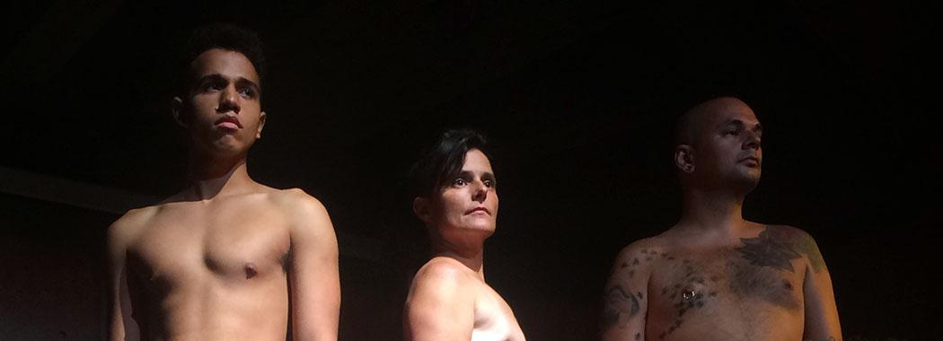 three shirtless performers