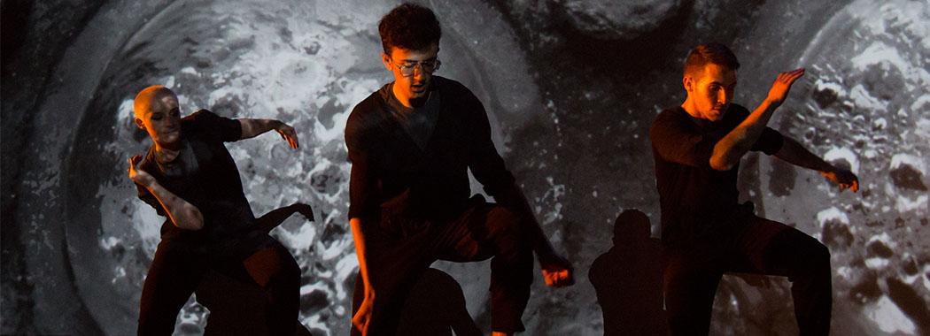three performers onstage wearing black