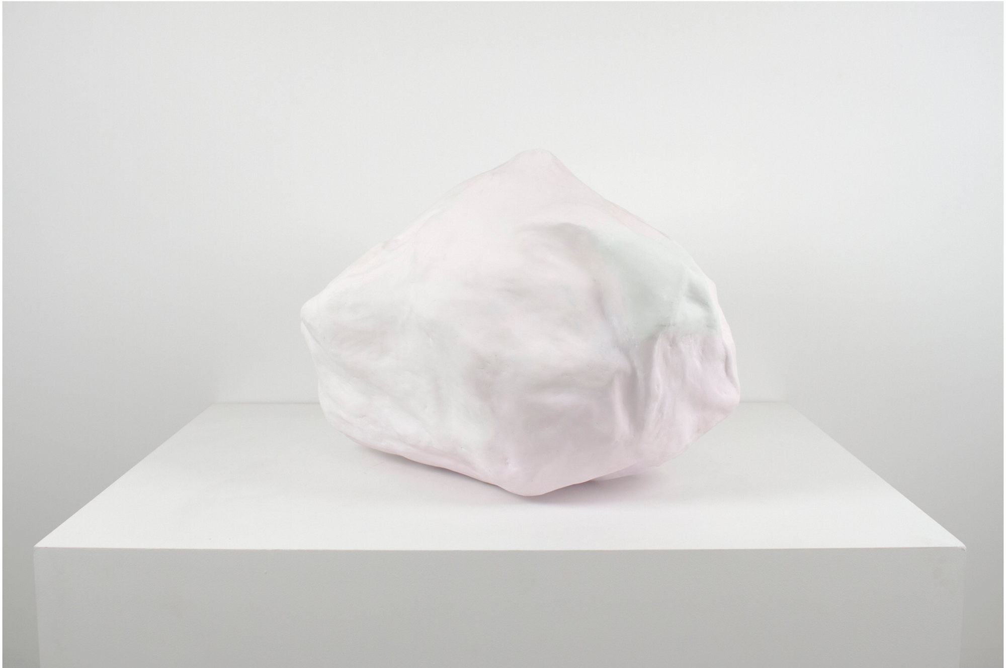 A white background and a white pedestal with a pink and white abstract sculpture