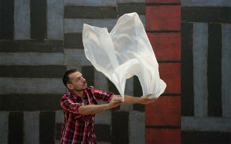 man waving a plastic bag