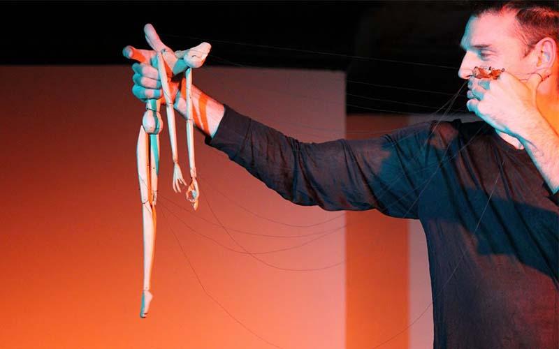 man holding a puppet