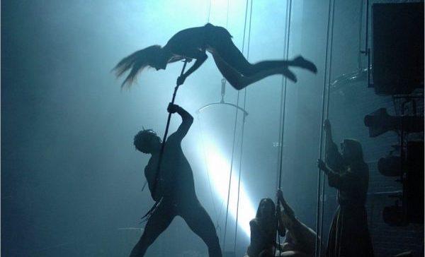 silhouette of performer in blue light